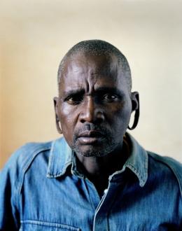"Mr. Mkhize, Alexandria, S.Africa (c-type print, 30x40"", 2004) ©Broomberg & Chanarin"