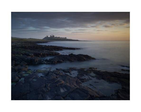 Hunstanburgh Castle at Dawn.